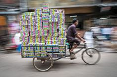 A cycle rickshaw delivers product.