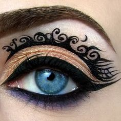 Use black gel liner to create a fantasy arabesque pattern over your lid. An exotic and original look.