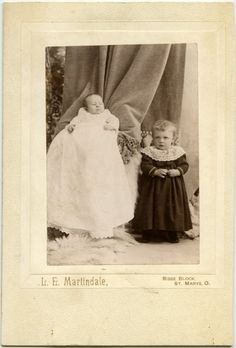 Sisters. Sisters  That baby looks like she's got it out for her big sister. Mom had better hold on tight.      Can U Spot The 19C INVISIBLE MOM?