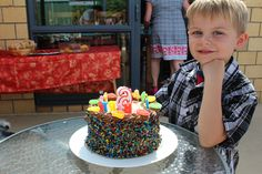 All grown up at 6, did not look too impressed with the cake.