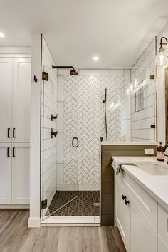Master bath.  White subway tile focal wall with brown grout.  Shiplap tile with glass door.  Wood like tile floors.  Dark hardware.