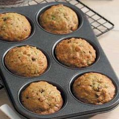"""Zucchini Muffins Recipe -""""These yummy zucchini bread muffins, packed full of currants and walnuts are an excellent way to use up your garden overload of zucchini,"""" raves Peg Gausz of Watchung, New Jersey. Blueberry Breakfast, Breakfast Muffins, Breakfast Recipes, Dessert Recipes, Desserts, Vegan Breakfast, Recipes Dinner, Yummy Zucchini Muffins, Zucchini Muffin Recipes"""