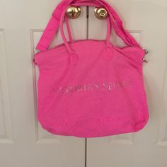 Large Pink Victoria's Secret canvas tote bag Large tote bag from Victoria's Secret. Has a shoulder strap and handles. Zips closed. Used but in good condition. Has been washed. Small stain in front lower corner. Canvas heavy duty fabric. Silver logo on the front. trades Victoria's Secret Bags Totes