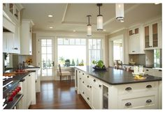 Large kitchen design with island and pendant lighting with  white cabinets.-Home and Garden Design Ideas