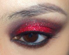 Scarlet Glitter Eye Tutorial  http://makeupbox.tumblr.com/post/19447497908/scarlet-slippers-red-glitter-winged-eye