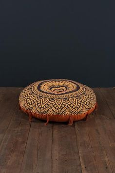 Black and Beige Round Pouffe with Hand-Stitching and Tassels