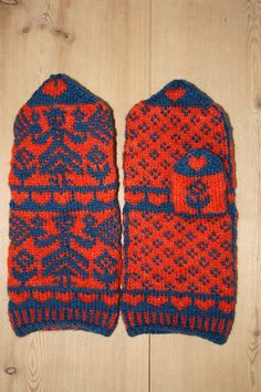 Orange mittens with blue ladies.