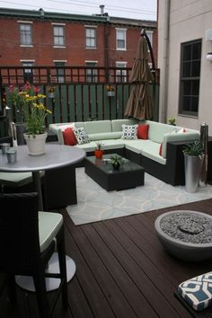 Classy and comfortable outdoor living space on a city apartment balcony  (viaBusybee Design)