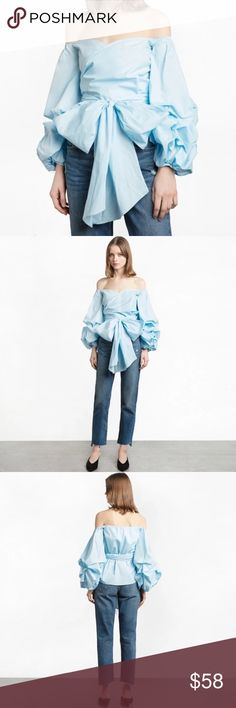 "Clayla Blue Bow Off The Shoulder Ruffle Top NWT Boutique Item. My new obsession!! This top is gorgeous! The Claya top features a pretty sea blue color palette (color best reflects last image), Ruffle detailing on the sleeves, off the Shoulder silhouette, and wrap around tie waist design.  S Measurement: Size 0-2 M Measurement: Size 4-6 L Measurement:  Size 8-10 * I wear a size small and I am 32C Bust, 26"" Waist Material: Poly Color: Blue  Handwash Imported Tops Blouses"