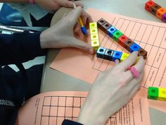 Triangle exploration lesson - Students use snap cubes to determine types of triangles they form.