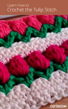 Learn how to crochet the tulip stitch in this lesson using three different colors of yarn, one for the dirt, one for the leaves, and one for the tulips.