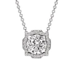 Harry winston-bell-web-mar pendant with a colorless round brilliant diamond center stone; featured here in a carat center stone, carats total diamond weight; Diamond Studs, Diamond Jewelry, Solitaire Diamond, Diamond Pendant Necklace Solitaire, Single Diamond Necklace, Diamond Earrings, Diamond Necklaces, Uncut Diamond, Stud Earrings