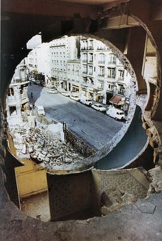 "Gordon Matta-Clark - Conical Intersect (1975) ""Conical Intersect manifested Matta-Clark's critique of urban gentrification in the form of a radical incision through two adjacent 17th-century buildings..."