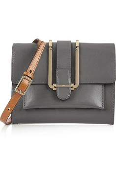 Gray leather (Calf) Shoulder strap Brown trims, gold hardware Front patch pocket, internal zipped pocket, leather interior (Lamb) Tab fastening at front flap