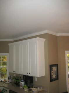 """Can This """"Miracle"""" Trim Can Solve Your Home Design Problems?: Use Crown Molding To Disguise Cabinet Soffits Crown Molding Kitchen, Ceiling Crown Molding, Moldings And Trim, Home Addition Plans, Kitchen Cabinets, House Design, Furniture, Molding Ideas, Home Decor"""