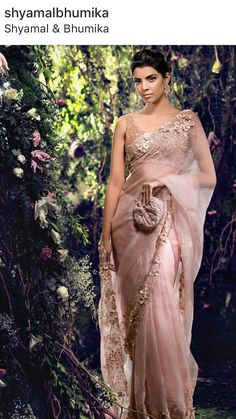 A flowing romantic blush organza saree with sculptured appliqued floral embroidery. Kindly WhatsApp on for more info. Desi Wedding Dresses, Indian Wedding Outfits, Indian Outfits, Bridal Dresses, Bridal Sari, Pakistani Outfits, Saree Wedding, Net Saree Designs, Saree Blouse Designs