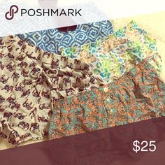 Buy 1 or all 4 pj shorts 1)blue and white tribal print with tie.                   2)white shorts with colorful elephants and a tie. 3)multicolored cheetah shorts.                               4) multi color flowered shorts with buttons.          Buy one pair for 7$ or all for 20$ Shorts