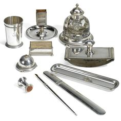 A Fabergé ten piece silver desk set, workmaster Anders Nevalainen, Moscow, 1899-1908, comprising a glass ink-well, a blotter, a beaker, a pen-tray, a quill-blotter, a quill, a paperknife, a match-striker, a desk bell and a desk seal with hard stone matrix, each chased with borders of acanthus leaves and with engraved initials HJ.