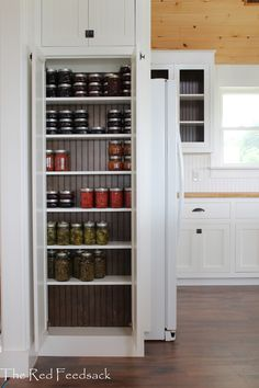 Narrow depth cabinets for cans next to the fridge.