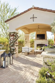 Mediterranean Cream Exterior with Outdoor Seating Area | LuxeSource | Luxe Magazine - The Luxury Home Redefined