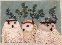 Finished Festive Owls in needlepoint
