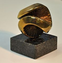 Bronze and granite #sculpture by #sculptor Jens Ingvard Hansen titled: 'Wheel of Life I (Round Ball abstract statue)'. #JensIngvardHansen
