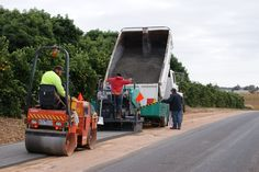 Laying a PolyCom treated footpath with pre treated material and a paving machine.