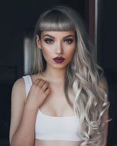 @_missbo is showstopping in silver long hair and edgy straight bangs . This 'do is perfect for dominating those weekend nights out on the town . Want the look? Get our 32mm Classic Wand to achieve these dazzling long curls✨ ! ##hairoftheday #NuMeStyle #loosewaves
