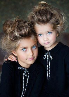 Not quite getting the Gibson girl hair do on these little ones, but dang, those eyes!