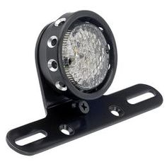 """The Comet Tail Light features very bright LEDs for your running light, brake light, and license plate illumination and are built into a 2-3/4"""" diameter aluminum housing. The lens appears clear but lights up red when running. Light is also visible through"""