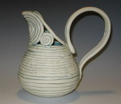 Coil pottery pitcher. I like this example of coil pottery because it looks clean and simple while actually being quite intricate and it has two uses: beauty and function