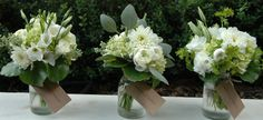 Sweet nosegays for homecoming dates.  White hydrangea, eucalyptus berry, dahlia, lisianthus, freesia, ranunculus and galax leaves.