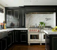 Black cabinets, marble splash back.