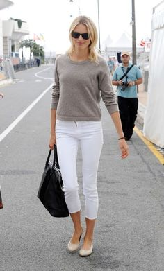New taupe Theory sweater, white jeans rolled, silver flats.  Is that a zipper fit problem on her, though, or fancy zipper?