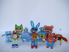 Cool handmade paper toys & robots by columbian artist Machintoy. Visit his Flickr page to download printable templates to make your own. @Erika Colby
