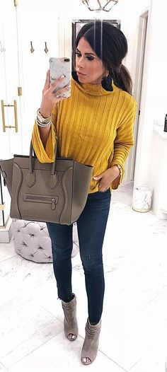 #fall #outfits women's yellow sweater and blue denim jeans
