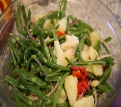 I grew up eating string bean and potato salad and i make it all the time.  We use little (or none) vinegar.  We also add chopped garlic, lots of fresh basil, and cannelini beans!  A family favorite!!
