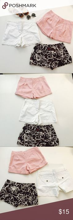 Three pairs of shorts size small medium. White shorts are by Tommy Hill figure. Red stripe shorts are by Romeo and Juliet. Brown shorts are bye XOXO. I'll shorts have a waste of 30 and a length of 11 three pairs of shorts shorts for the summer. Tommy Hilfiger Shorts