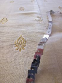 Elegant hand finished suit for cocktails and ceremonies (of Tazeen Hasan). Three pieces: ivory and gold trousers in shiny silk with small de...