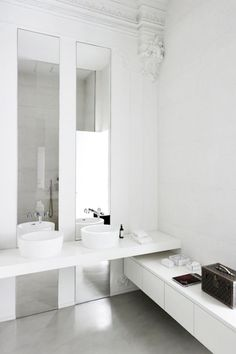 Modern, white. Love the height dimensions with the mirrors and the sleek oval cupped basins