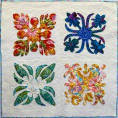 """Kapa Hawaii Sampler, 43"""" × 43"""" by Toni Getz.  The Quilt Works Inc. Pattern: Quiltsmart, Printed Interface, by Bette Runnels."""