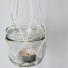 Want to add a little retro feel to your home decor? Make these super easy to DIY hanging candles for in or outdoors!
