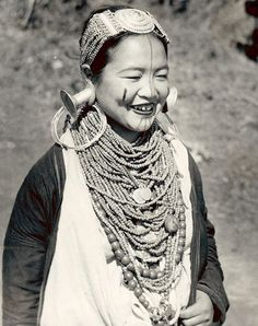 """Woman with Face Tattoo and in Costume with Silver Ear Plugs And Ornaments 1954"" India Assam/Nefa/Arunachal Pradesh/Kameng FD. Photographer: Verrier Elwin"