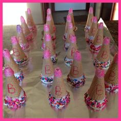Mega phones made out of sugar cone and melted chocolate. Great favors for a cheer themed birthday party!