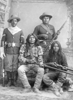 A Tenth US Cavalry trooper poses with three Apache Indian scouts (Courtesy Sharlot Hall Museum).