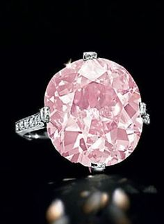 Formerly the property of Huguette M. Clark. A BELLE ÉPOQUE EXCEPTIONAL COLOURED DIAMOND RING, BY DREICER & CO., CIRCA 1910. Set with a modified cushion-cut fancy vivid purplish pink diamond, weighing approximately 9.00 carats, to the single-cut diamond prongs, gallery and shoulders, mounted in platinum. Signed D & Co. for Dreicer & Co #BelleEpoque #ClarkPink