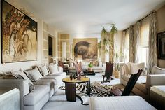 """In another New York apartment — this one in the Carlyle and belonging to duty-free tycoon Robert Miller and his wife, Chantal — François  Catroux drew inspiration for his design from the building's Art Deco aesthetic. """"A lot of Art Deco designers were influenced by Africa,"""" he notes of the room's safari accents. In this space, Catroux deployed both furniture actually from Africa and """"interpretations of it in the French moderne style,"""" as well as artworks by Jean Dunand and Fernando Botero."""