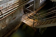 ianference:  Journeying into the lower levels of the New Milford plant of the Hackensack Water Works sometimes feels like acting out an Indiana Jones flick. Everything seen in this photo - of a staircase leading down into one of the underlayers - is completely underwater after a day or two of rain. On the other hand, during a dry spell, one can get even one level lower than what is pictured. At the bottom of the stairs is a maze of rooms and tunnels, some flooded, some not, weather…