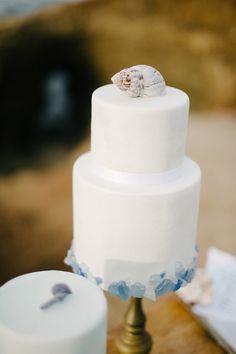 fondant wedding cake - photo by John Schnack Photography http://ruffledblog.com/seaside-wedding-inspiration-shoot