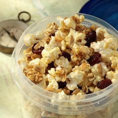 Popcorn Trail Mix: A crunchy trail mix with popcorn, granola, oats, cranberries and  sunflower seeds flavored with honey